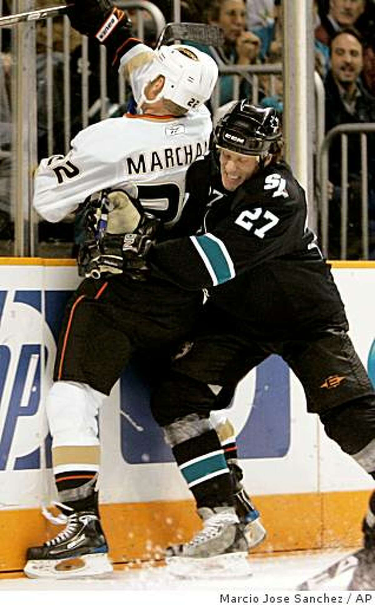 San Jose Sharks center Jeremy Roenick, right, checks Anaheim Ducks center Todd Marchant against the boards during the second period of an NHL hockey game in San Jose, Calif. on Thursday, Dec. 11, 2008. (AP Photo/Marcio Jose Sanchez)