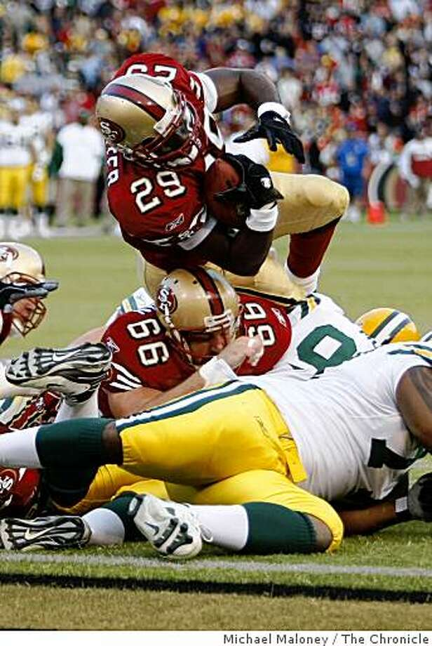 San Francisco 49ers DeShaun Foster crosses the goal line for a TD in the 1st half.The San Francisco 49ers host the Green Bay Packers in an NFL preseason game at Candlestick Park in San Francisco, Calif., on August 16, 2008. Photo: Michael Maloney, The Chronicle