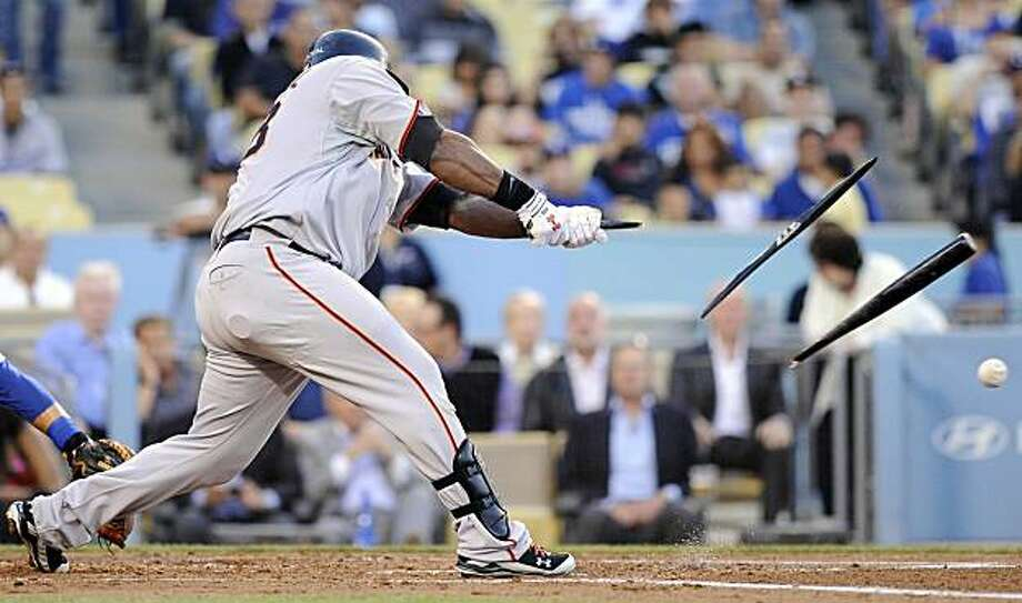 San Francisco Giants' Pablo Sandoval, left, breaks his bat during the second inning of a baseball game against the Los Angeles Dodgers, Wednesday, July 21, 2010, in Los Angeles. Sandoval was thrown out at first on the play. Photo: Mark J. Terrill, AP