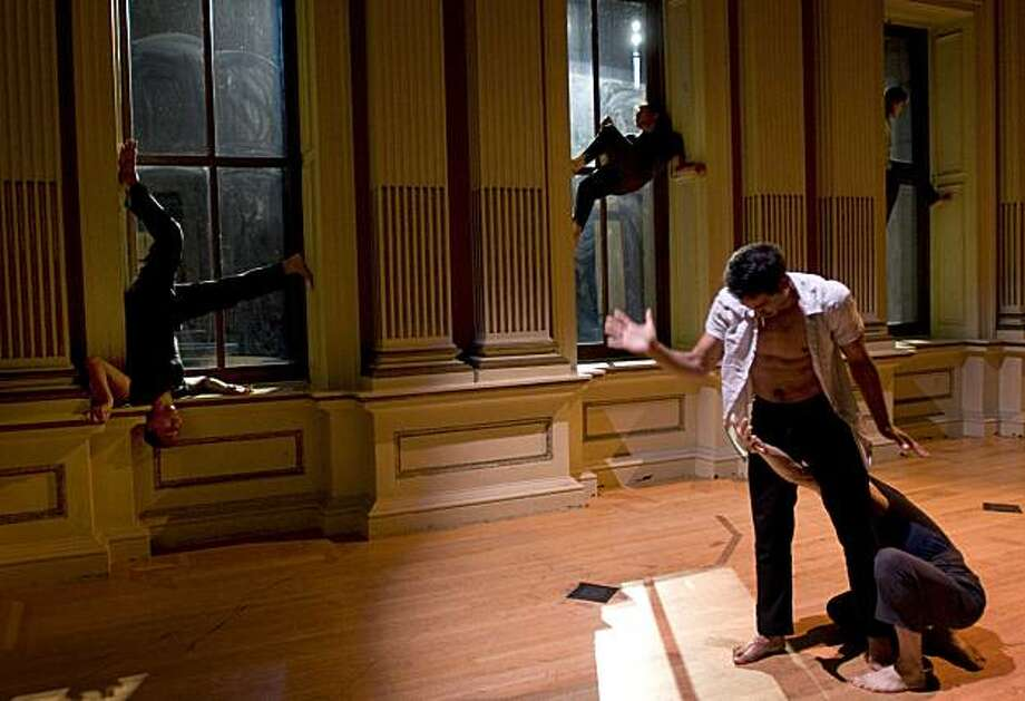 "Actors perform their roles in one of the five different stages during the final dress rehearsal of ""Traveling Light"" presented by The Joe Goode Performance Group inside the Old San Francisco Mint on Tuesday, July 6, 2010. Photo: Chad Ziemendorf, The Chronicle"