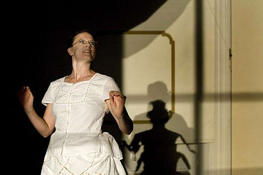 """Jessica Swanson plays her part within one of the several rooms of Joe Goode's """"Traveling Light during its final dress rehearsal inside the Old San Francisco Mint on Tuesday, July 6, 2010. Photo: Chad Ziemendorf, The Chronicle"""