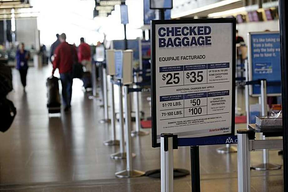 In this photograph taken June 7, 2010, an American Airlines sign listing the fees for checked baggage is shown, at Seattle-Tacoma International Airport in Seattle. The Government Accountability Office recommended in a report released Tuesday, July 13, that the government improve the disclosure of airline fees, not only by airlines, but also by travel booking services. Photo: Ted S. Warren, AP
