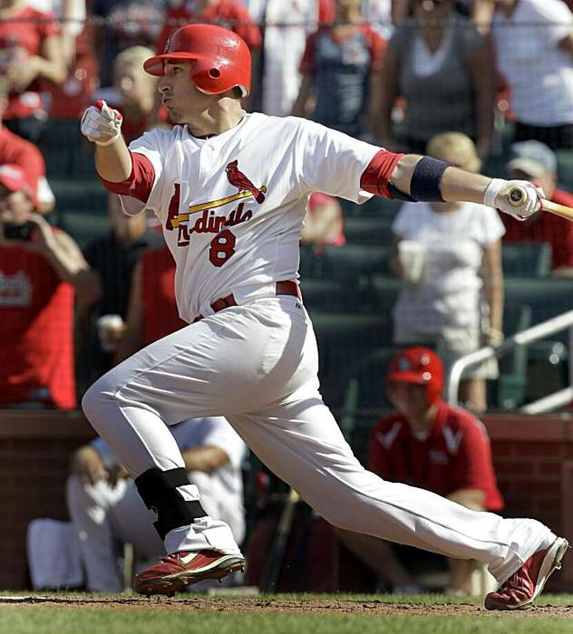 St. Louis Cardinals' Allen Craig hits an RBI single to score Yadier Molina and tie the baseball game during the ninth inning against the Los Angeles Dodgers Sunday, July 18, 2010, in St. Louis. The Cardinals won 5-4. Photo: Jeff Roberson, AP