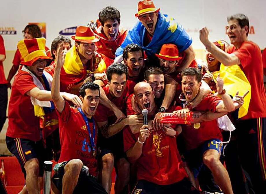 Members of the winning national soccer team celebrate their victory after a parade in Madrid on Monday, July 12, 2010. Spain won the World Cup after defeating the Netherlands 1-0 on Sunday. (AP Photo/Emilio Morenatti) Photo: Emilio Morenatti, ASSOCIATED PRESS