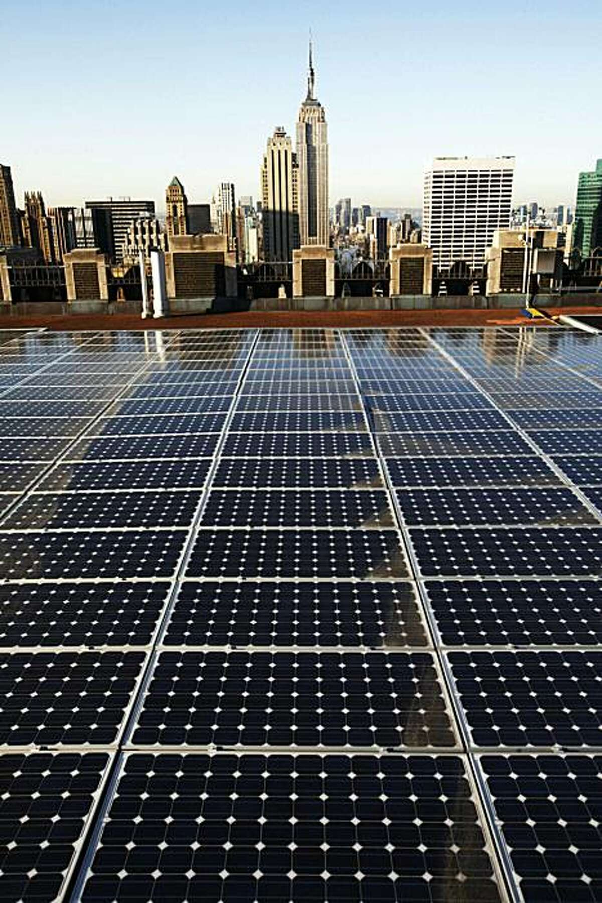 In this March 24, 2009 photo, solar panels are in place on a Rockefeller Center rooftop in midtown Manhattan in New York. The fledgling renewable energy industry has surged over much of the past decade, adding jobs at more than twice the national rate, according to a Pew Charitable Trusts study released Wednesday, June 10, 2009.(AP Photo/Mark Lennihan)