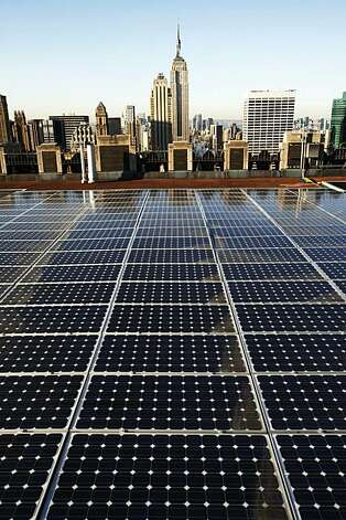 In this March 24, 2009 photo, solar panels are in place on a Rockefeller Center rooftop in midtown Manhattan in New York. The fledgling renewable energy industry has surged over much of the past decade, adding jobs at more than twice the national rate, according to a Pew Charitable Trusts study released Wednesday, June 10, 2009.(AP Photo/Mark Lennihan) Photo: Mark Lennihan, AP