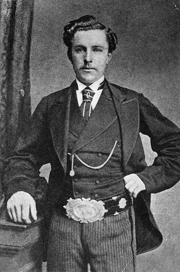 circa 1873:  Scottish golfer 'Young' Tom Morris (1851 - 1875) wearing the British Open belt which he won four times. 'Young' Tom and his father 'Old' Tom became the only father and son to hold successive Open titles when 'Old' Tom became the oldest player to win a title, aged 46 years and 99 days, in 1867 and 'Young' Tom won in 1868 to become the youngest Open Champion. 'Young' Tom began his playing career at an early age winning an exhibition match at Perth aged only 13, and winning his first professional tournament three years later.  (Photo by James Hardie/Hulton Archive/Getty Images) Photo: James Hardie, Getty Images