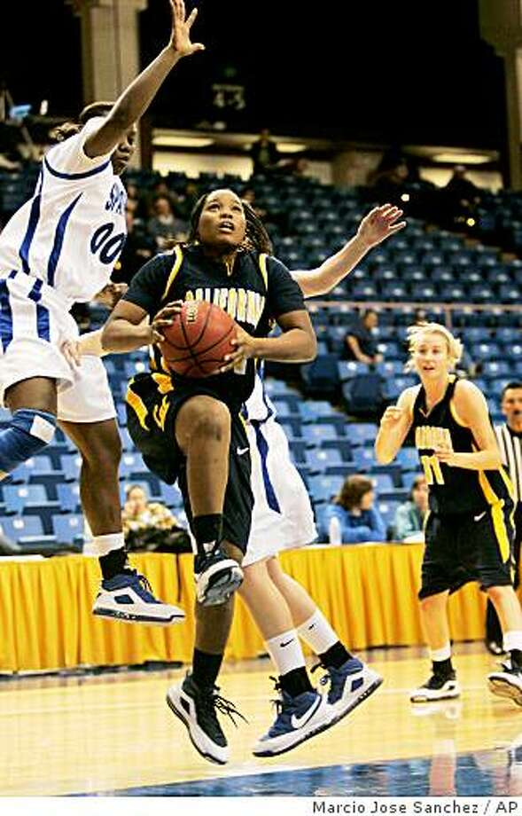 California's Alexis Gray-Lawson, center, drives past San Jose State's Chasity Shavers, left, in the second half of an NCAA college basketball game in San Jose, Calif. on Friday, Dec. 12, 2008. (AP Photo/Marcio Jose Sanchez) Photo: Marcio Jose Sanchez, AP