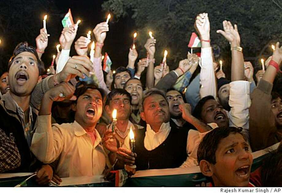 People participate in a candle light vigil to pay tribute to those killed in recent terror attacks in Mumbai, in Allahabad, India, Friday, Dec. 5, 2008. (AP Photo/Rajesh Kumar Singh) Photo: Rajesh Kumar Singh, AP