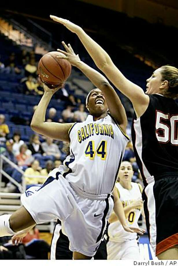 California's Ashley Walker (44) attempts a shot while guarded by Princeton's Cheryl Stevens (50) during the first half of an NCAA college women's basketball game in Berkeley, Calif., Saturday, Dec. 6, 2008. (AP Photo/Darryl Bush) Photo: Darryl Bush, AP
