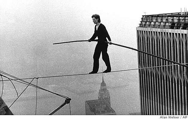 "In this Aug. 7, 1974 file photo, Philippe Petit, a French high wire artist, walks across a tightrope suspended between the World Trade Center's Twin Towers in New York.  Philippe Petit stars in ""Man on a Wire,"" directed by James Marsh. Photo: Alan Welner, AP"