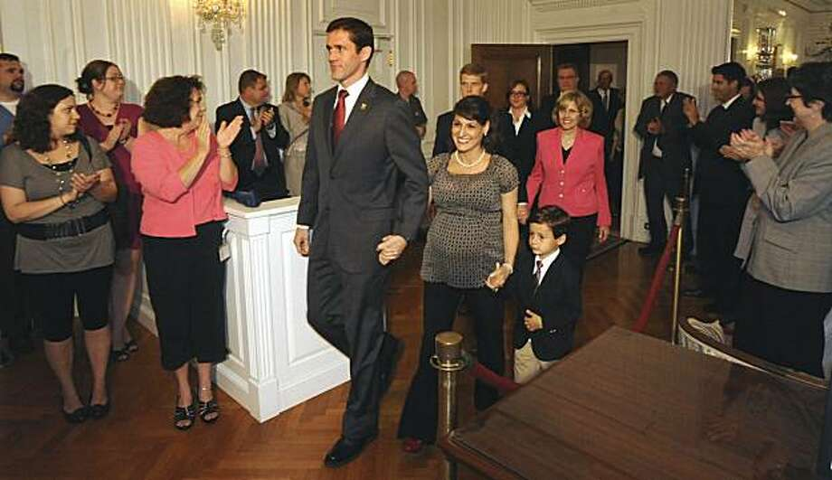 Carte Goodwin, with his wife, Rochelle and son, Wesley, enter the governors reception room for a press conference with Gov. Joe Manchin at the Capitol in Charleston, WV., Friday July 16, 2010. Manchin has chosen former chief counsel Carte Goodwin, a member of a prominent West Virginia family, to succeed the late U.S. Sen. Robert C. Byrd. Photo: Lawrence Pierce, AP