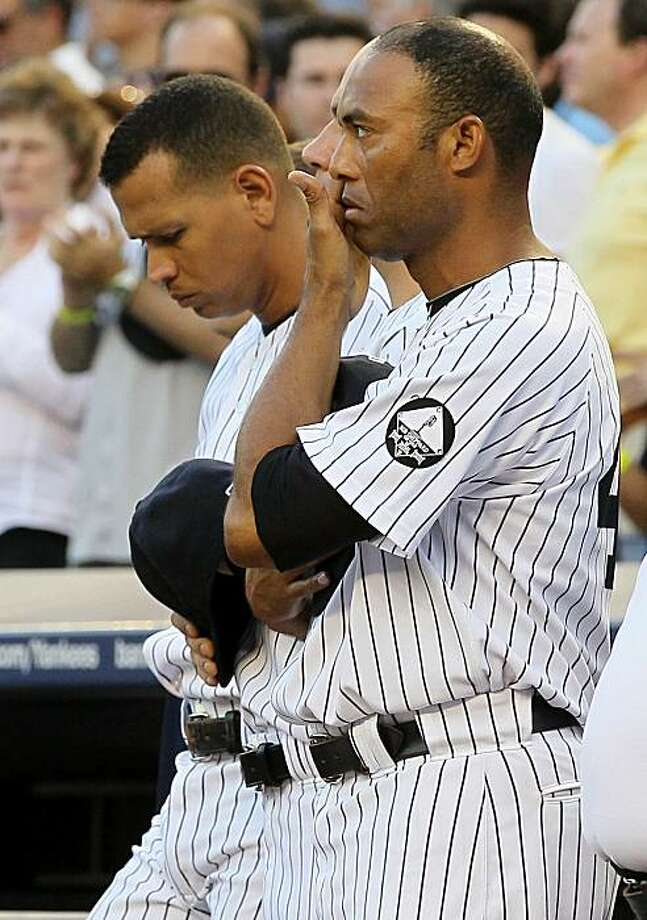 NEW YORK - JULY 16:  Mariano Rivera #42 and Alex Rodriguez #13 of the New York Yankees look on during the ceremony for owner George Steinbrenner and Yankee Stadium public address announcer Bob Sheppard before the game against theTampa Bay Rays on July 16,2010 in the Bronx borough of New York City. Steinbrenner died on July 13 at age 80 and Sheppard passed on July 11 at age 99. Photo: Jim McIsaac, Getty Images