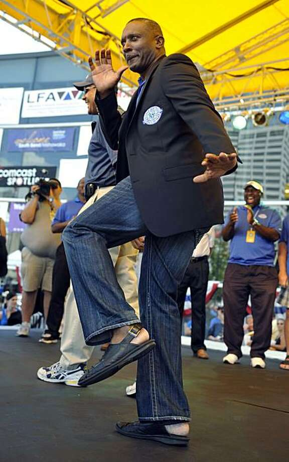 Tim Brown, Notre Dame wide receiver 1984-87, strikes the Heisman pose after receiving his Hall of Fame jacket during the Hall Enshrinement Festival Saturday July 17, 2010 in South Bend, Ind. Photo: Joe Raymond, AP