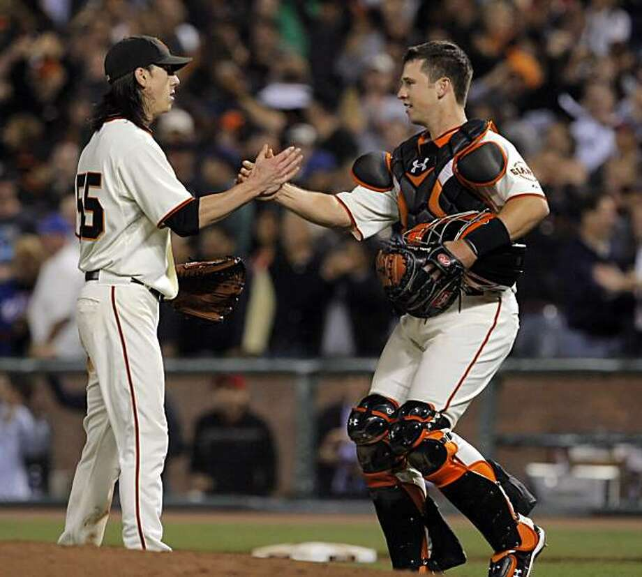 Tim Lincecum, left, and Buster Posey celebrate after Lincecum finished a complete game shutout of the Mets at AT&T Park on Thursday. Photo: Carlos Avila Gonzalez, The Chronicle