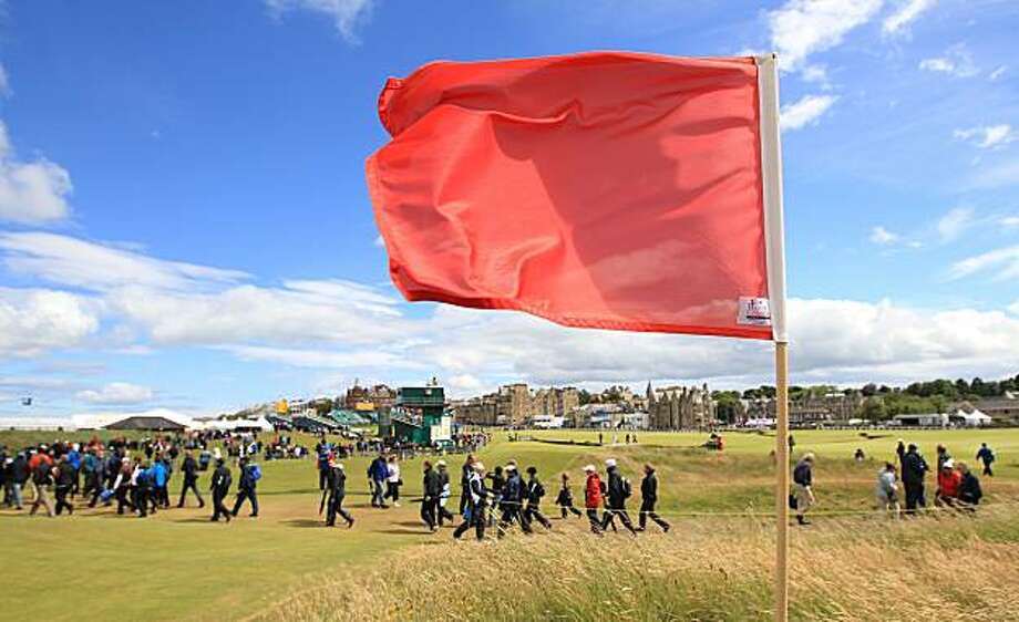 A flag blows in the wind on the Old Course at St. Andrews, Scotland as play was suspended due to strong wind in the second round of the British Open Golf Championship, Friday, July 16, 2010. Photo: Jon Super, AP