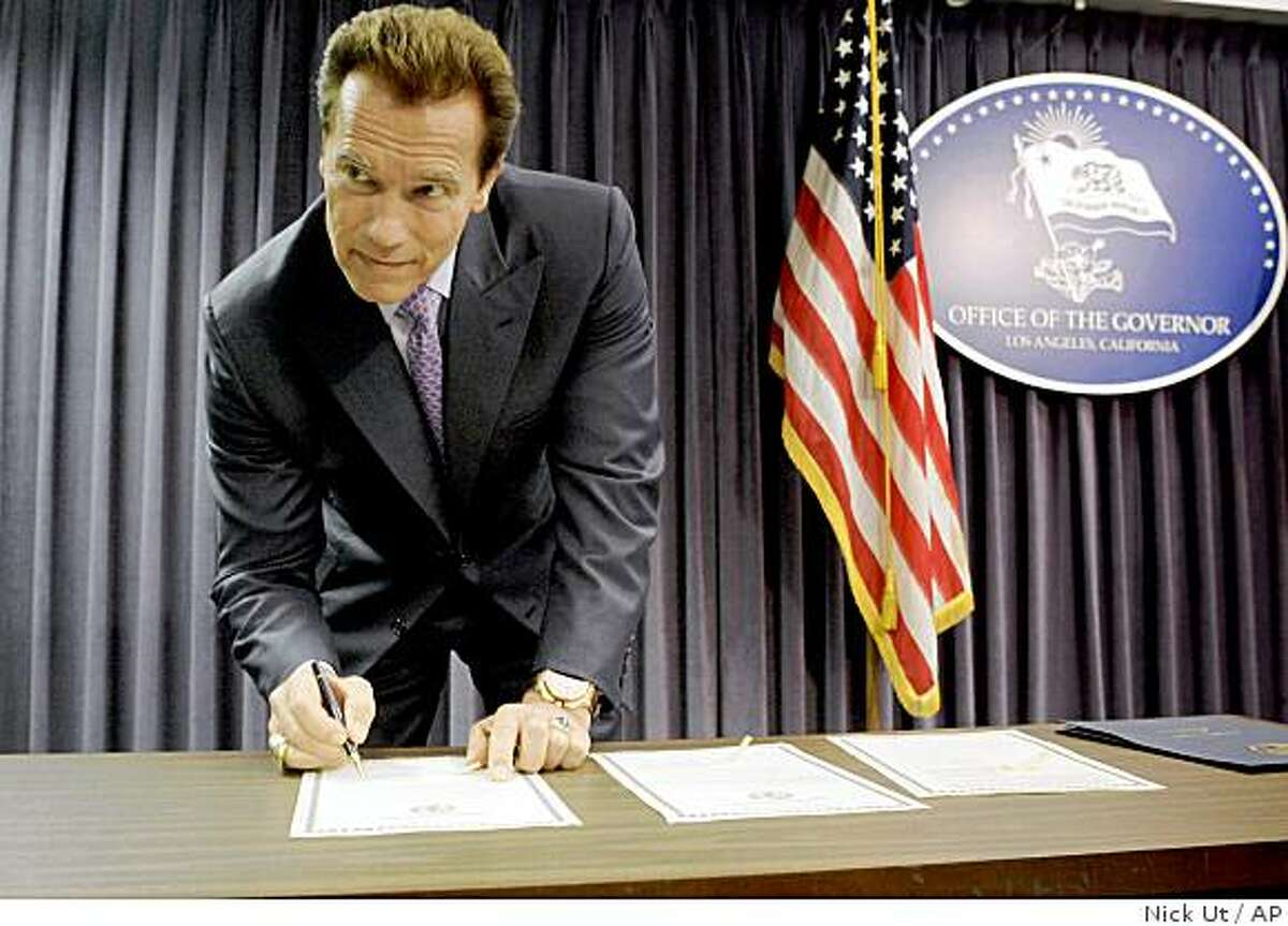 California Gov. Arnold Schwarzenegger signs declarations at a news conference in his Los Angeles office. Schwarzenegger declared a fiscal emergency and called lawmakers into a special session to address California's $11.2 billion budget deficit.