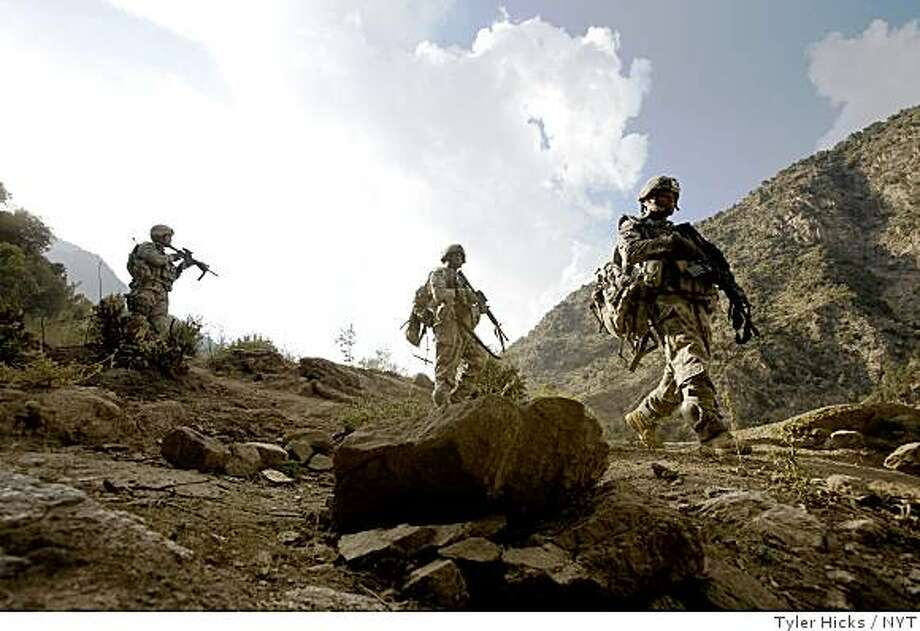 (NYT1) KAMU, Afghanistan -- Dec. 6, 2008 -- AFGHAN-PAKISTAN-US --  U.S. soldiers from the 6th Squadron, 4th Cavalry hike down from a position at Combat Outpost Lowell, in Kamu, Afghanistan, in a Oct. 15, 2008 file photo.   (Tyler Hicks/The New York Times) Photo: Tyler Hicks, NYT