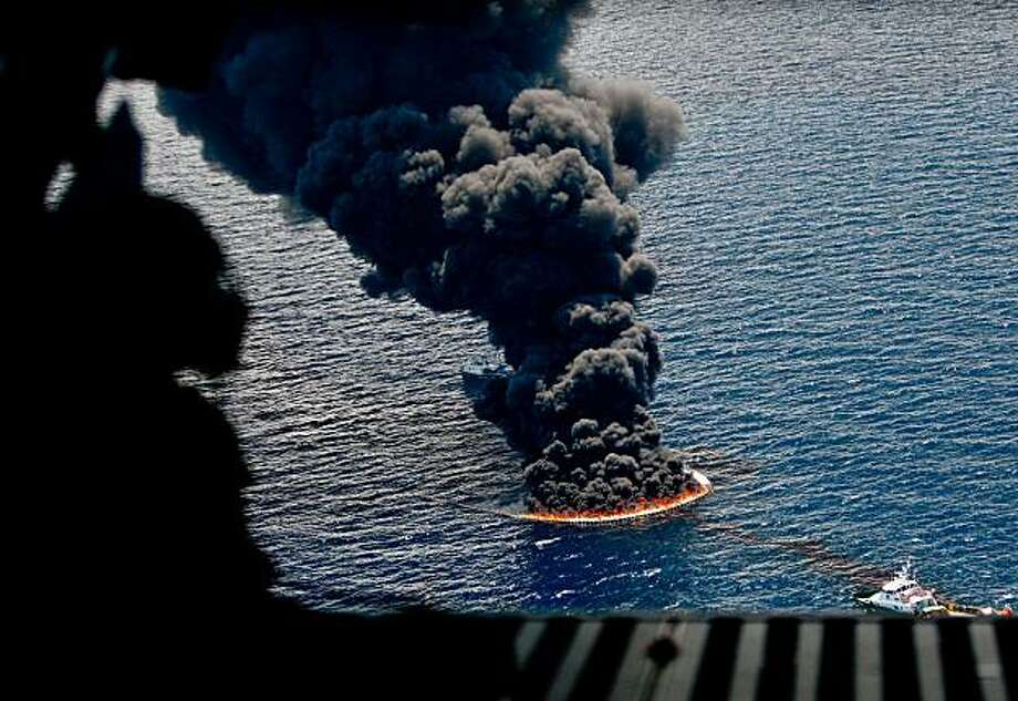 A controlled burn of oil on the surface of the water is seen from a U.S. Coast Guard C-144 aircraft near the site of the BP Plc Deepwater Horizon oil spill in the Gulf of Mexico off the coast of Louisiana, U.S., on Sunday, July 11, 2010. BP is installing a new cap on the leaking well, and attaching the Helix Producer I vessel may increase the oil-collecting capacity to as much as 80,000 barrels a day. Photographer: Derick E. Hingle/Bloomberg Photo: Derick E. Hingle, Bloomberg