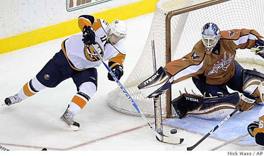 New York Islanders' Andy Hilbert (11) tries to get the puck past Washington Capitals goalie Brent Johnson (1) during the second period of an NHL hockey game, Thursday, Dec. 4, 2008, in Washington. (AP Photo/Nick Wass) Photo: Nick Wass, AP