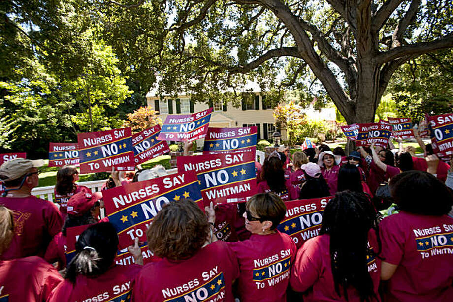Protesters turn to face Meg Whitman's house to deliver their message during an assembly of the California Nurses Association in front of California Governor candidate Meg Whitman's house on Thursday, July 15, 2010 in Atherton, Calif. Photo: Chad Ziemendorf, The Chronicle