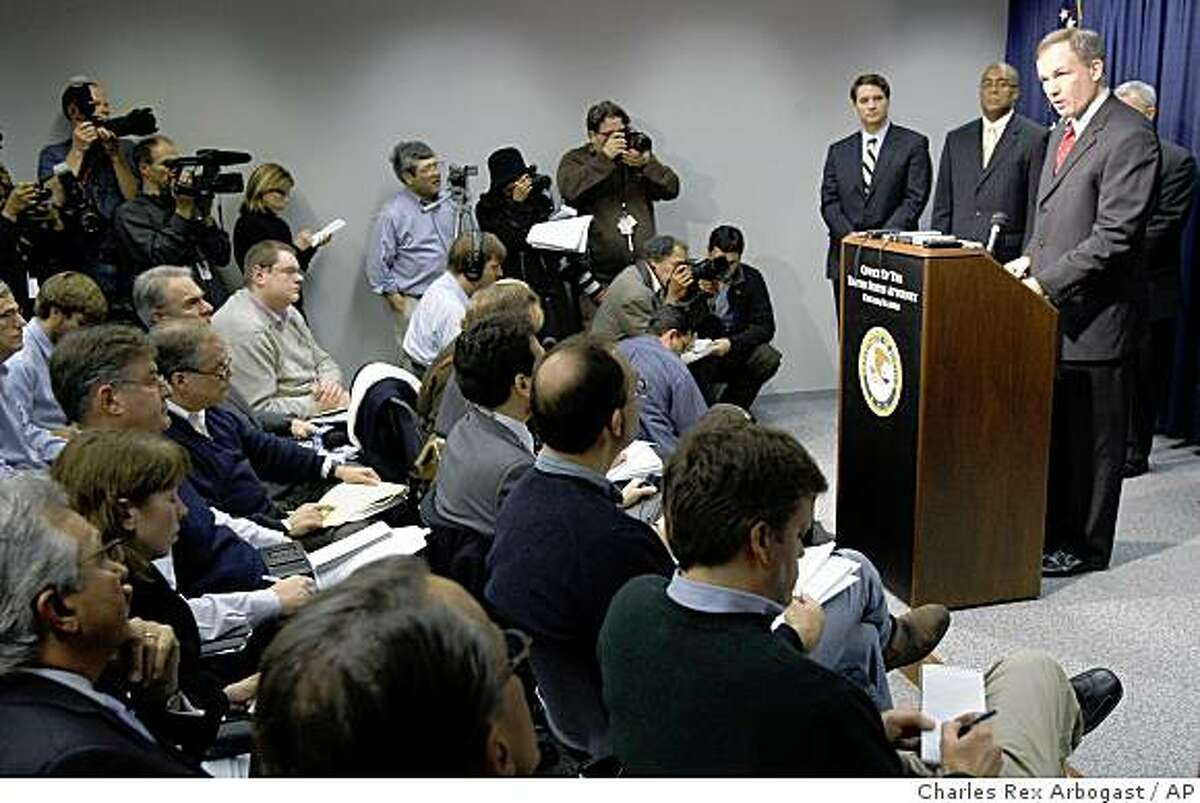 U.S. Attorney Patrick Fitzgerald, right, talks about the criminal complaint against Illinois Gov. Rod Blagojevich on corruption charges during a news conference in Chicago, Tuesday, Dec. 9, 2008. (AP Photo/Charles Rex Arbogast)