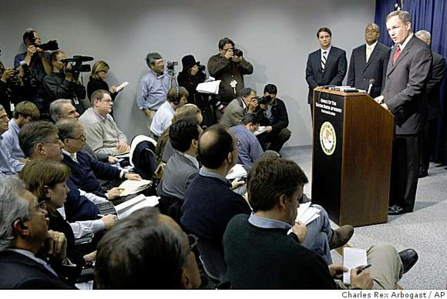 U.S. Attorney Patrick Fitzgerald, right, talks about the criminal complaint against Illinois Gov. Rod Blagojevich on corruption charges during a news conference in Chicago, Tuesday, Dec. 9, 2008. (AP Photo/Charles Rex Arbogast) Photo: Charles Rex Arbogast, AP