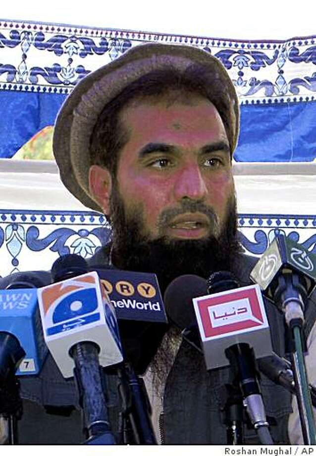 ** FILE ** In this file photo dated June 28, 2008, Pakistani Zaki-ur-Rehman Lakhvi speaks during a rally at Muzaffarabad, in Pakistani controlled Kashmir, Pakistan, Saturday, June 28, 2008. Security forces overran a militant camp on the outskirts of Pakistani Kashmir's main city and seized an alleged mastermind of the attacks that shook India's financial capital last month, officials said Monday. Backed by a helicopter, the troops grabbed Zaki-ur-Rehman Lakhvi among at least 12 people taken Sunday in the raid on the riverbank camp run by the banned group Laskhar-e-Taiba in Pakistani Kashmir, the officials said.  (AP Photo/Roshan Mughal) Photo: Roshan Mughal, AP