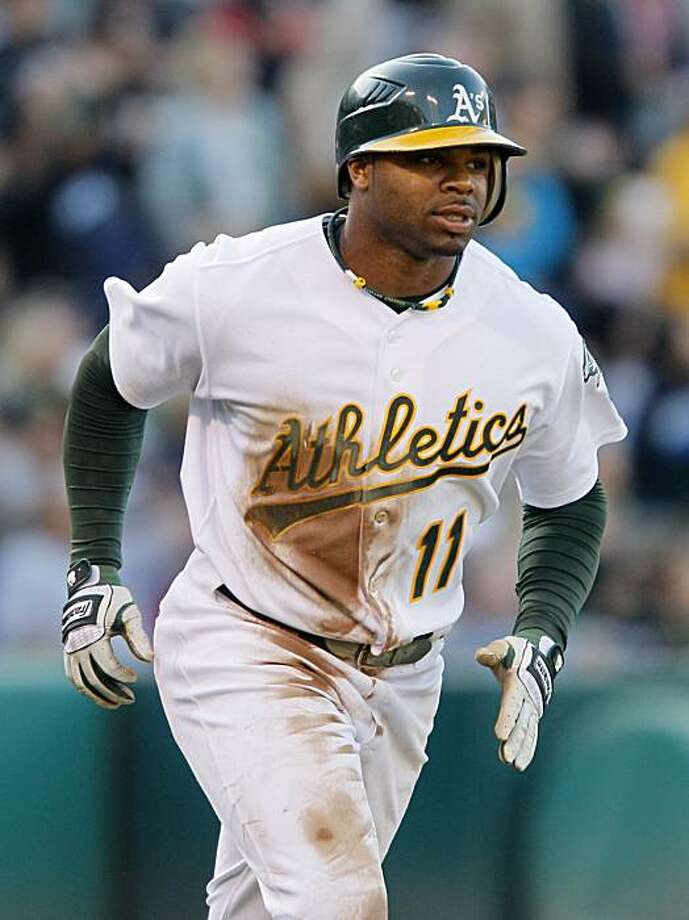 Oakland Athletics' Rajai Davis circles the bases after hitting a grand slam off Los Angeles Angels starting pitcher Scott Kazmir during the third inning of their baseball game in Oakland, Calif., Saturday, July 10, 2010. Photo: Eric Risberg, AP