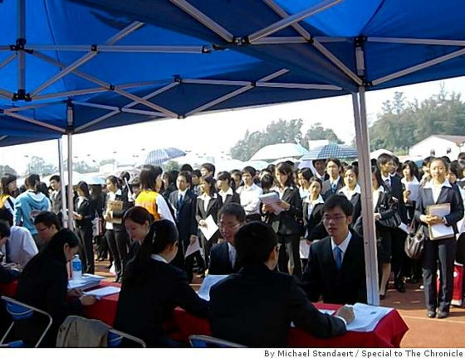 Prospective employers interview Chinese university students at a job fair on the campus of South China Agricultural University in Guangzhou city on Nov. 24. Photo: By Michael Standaert, Special To The Chronicle