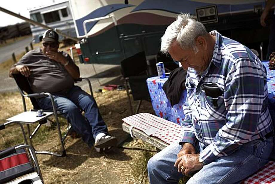 Robert Rodriguez (l to r) of Oakdale and John Fagundes of Oakdale talk at the Westside Park Campground in Bodega Bay, Calif. on Thursday July 15, 2010.  Two people drowned and another two were missing after heavy surf overturned a boat just north of Point Reyes National Seashore on Wednesday morning. Rodriguez and Fagundes, as well as the two who drowned and two who are missing, were part of a large group of fisherman and their families who gathered annually at Westside Park Campground. Photo: Lea Suzuki, The Chronicle