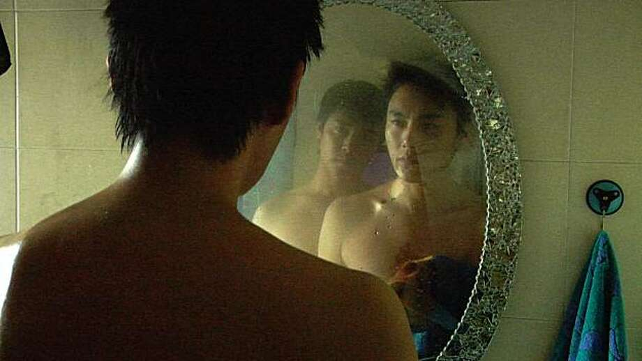 "Chen Sicheng, left in mirror, and Qin Hao appear in a scene in, ""Spring Fever."" Photo: Strand Releasing"