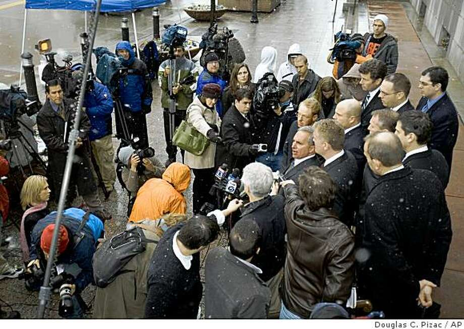Attorney Mark Hulkower, center right, speaks for himself and the other co-attorneys for five Blackwater Worldwide security guards to the media outside of federal court Monday, Dec. 8, 2008, in Salt Lake City. The guards were indicted for the 2007 shooting of Iraqi civilians. (AP Photo/Douglas C. Pizac) Photo: Douglas C. Pizac, AP