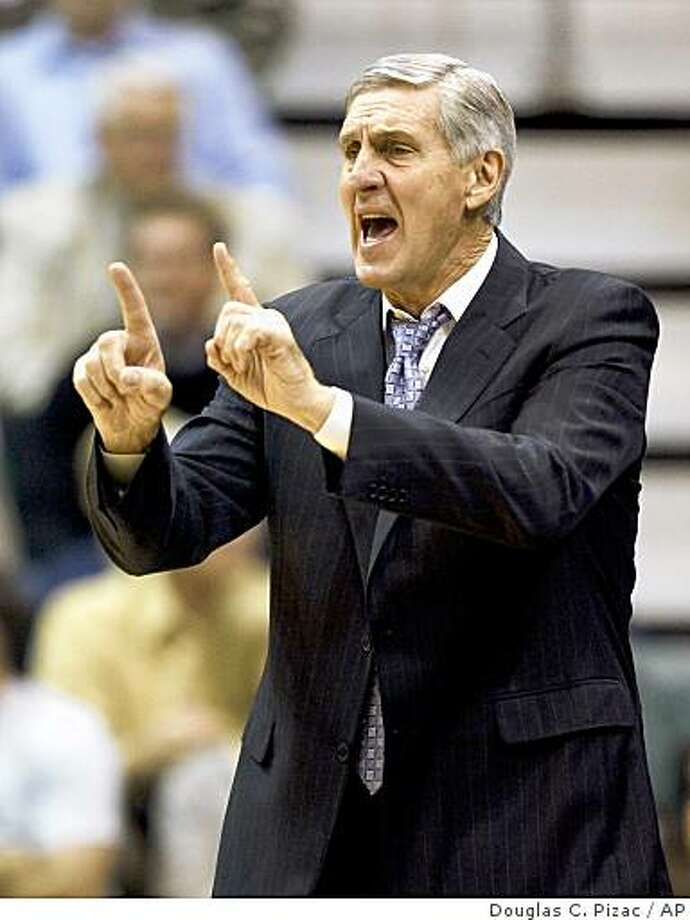 **FILE**In this Nov. 7, 2008 file photo, Utah Jazz head coach Jerry Sloan signals his players during the first quarter against the Oklahoma City Thunder in an NBA basketball game in Salt Lake City.  Sloan was going for his 1,000th career win. Sloan will reach the longest tenure of a coach in major pro sports on Tuesday Dec. 9, 2008 on his 20th anniversary of taking over the Jazz.  (AP Photo/Douglas C. Pizac, File) Photo: Douglas C. Pizac, AP