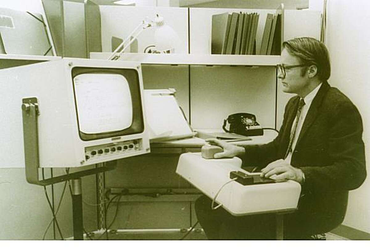 Doug Engelbart of the Stanford Research Institute works on the first personal computer, December, 1968. Photo courtesy of Stanford Research Institute
