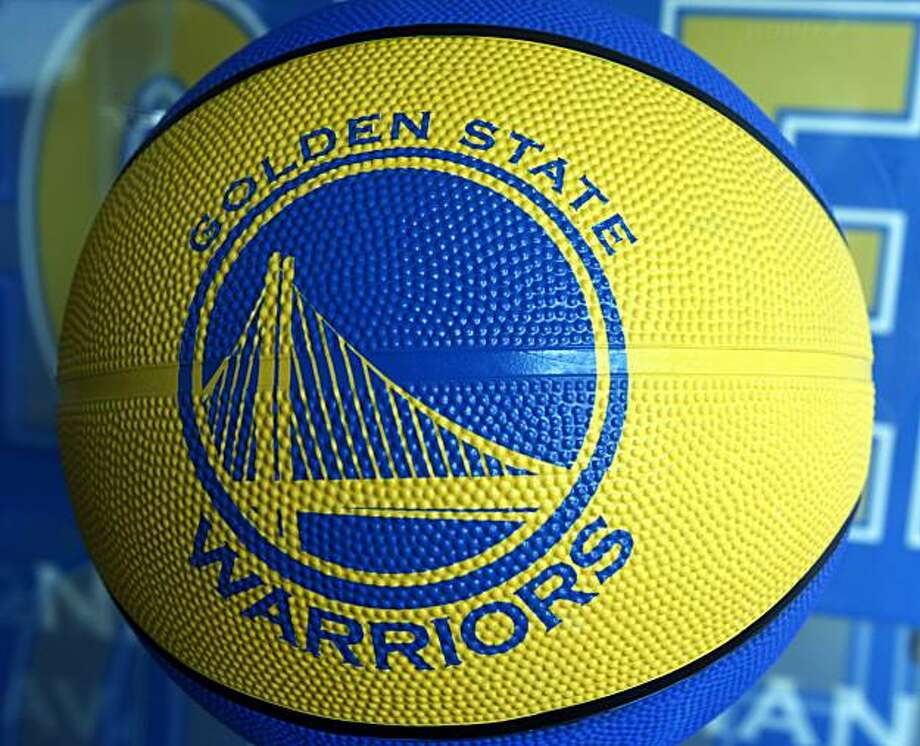 The new Golden State Warrior logo is seen on a basketball for sale at the Warrior team store Wednesday, July 14, 2010, in Oakland, Calif.  Golden State Warriors owner Chris Cohan reached an agreement Thursday to sell the franchise for a record $450 million to Boston Celtics minority partner Joe Lacob and Mandalay Entertainment CEO Peter Guber. Photo: Ben Margot, AP