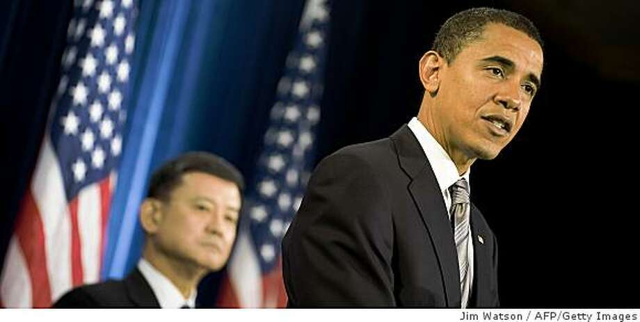 US President-elect Barack Obama (R) nominates General Eric Shinseki for the post of Secretary of the Department of Veterans Affairs during a press conference in Chicago, Illinios, December 7, 2008.  Shinseki, who had been the army's chief of staff, was ousted by former defense secretary Donald Rumsfeld after testifying in Congress that it would take several hundred thousand US troops to subdue Iraq after the war -- an opinion that broke sharply with Rumsfeld's.  AFP PHOTO/Jim WATSON (Photo credit should read JIM WATSON/AFP/Getty Images) Photo: Jim Watson, AFP/Getty Images