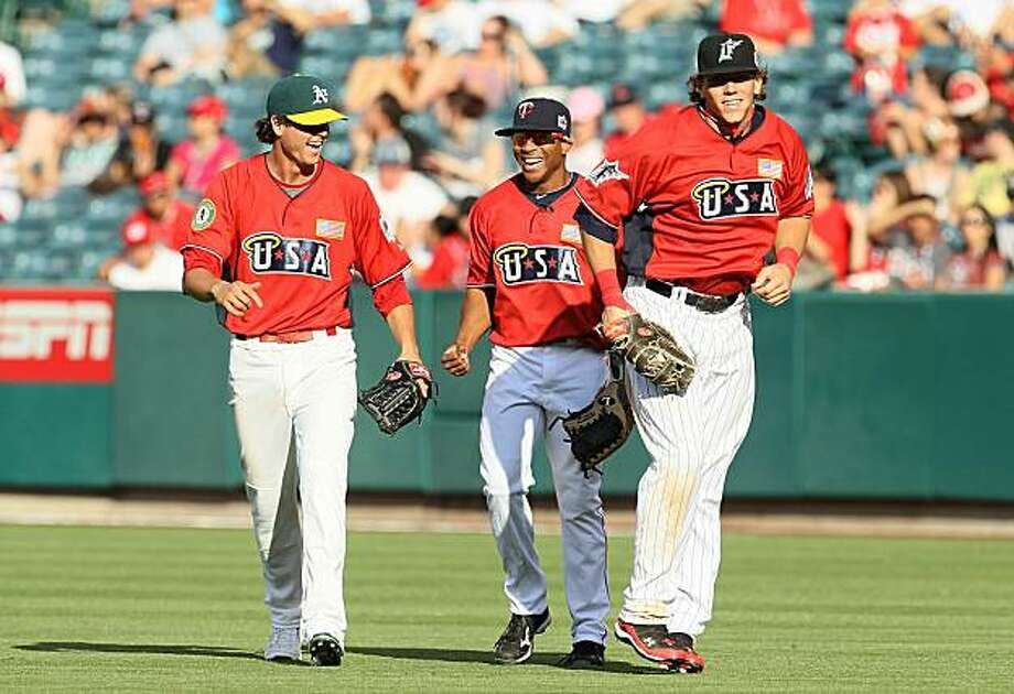 ANAHEIM, CA - JULY 11:  U.S. Futures All-Star Grant Green #2 of the Oakland Athletics,  U.S. Futures All-Star Ben Revere #7 of the Minnesota Twins and U.S. Futures All-Star Logan Morrison #24 of the Florida Marlins walk back during the 2010 XM All-Star Futures Game at Angel Stadium of Anaheim on July 11, 2010 in Anaheim, California. Photo: Stephen Dunn, Getty Images