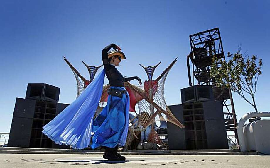 Wendy Albrecht of San Rafael dances Saturday as San Francisco's Bayview community recognized outstanding artists and musicians by holding a SuperHero Street Fair at Indiana and Cesar Chavez streets. Photo: Lance Iversen, The Chronicle