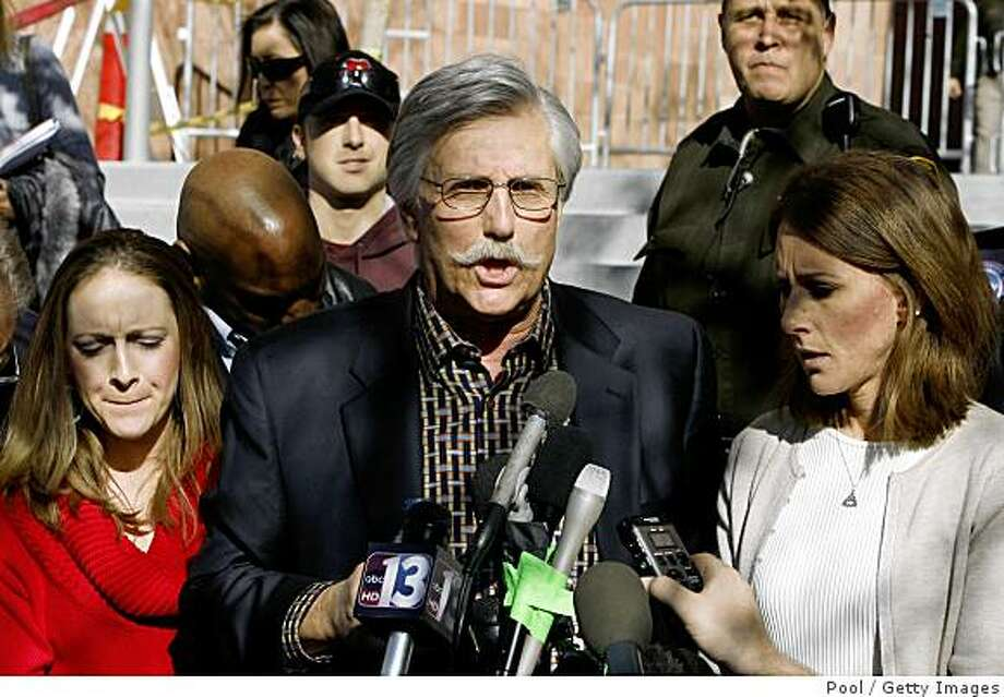 """LAS VEGAS - DECEMBER 5:  Fred Goldman (C), father of Ron Goldman, speaks to reporters after O.J. Simpson's sentencing as Lauren Luebker (L) and Kim Goldman (R) Ron Goldman's sister, listen at the Clark County Regional Justice Center December 5, 2008 in Las Vegas, Nevada.  Simpson and co-defendant Clarence """"C.J."""" Stewart were sentenced on 12 charges, including felony kidnapping, armed robbery and conspiracy related to a 2007 confrontation with sports memorabilia dealers in a Las Vegas hotel. (Photo by Issac Brekken-Pool/Getty Images) Photo: Pool, Getty Images"""