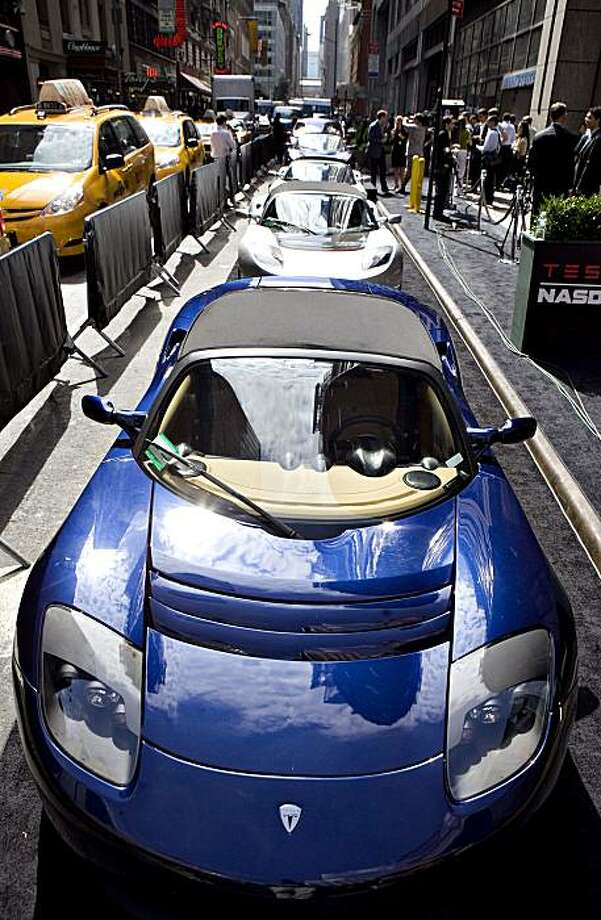 Tesla Motors Inc. electric cars sit on display outside the Nasdaq Marketsite in New York, U.S., on Tuesday, June 29, 2010. Tesla Motors Inc., the electric car company that hasn't posted a profit, raised $226 million selling shares above its forecast price range in the first initial public offering of a U.S. automaker in a half century. Photographer: Daniel Acker/Bloomberg Photo: Daniel Acker, Bloomberg