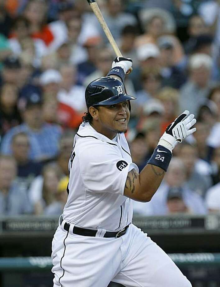 DETROIT - JULY 09:  Miguel Cabrera #24 of the Detroit Tigers hits a sacrifice fly in the second inning scoring Ryan Raburn  during the game against the Minnesota Twins on July 9, 2010 at Comerica Park in Detroit, Michigan. The Tigers defeated the Twins 7-3. Photo: Leon Halip, Getty Images