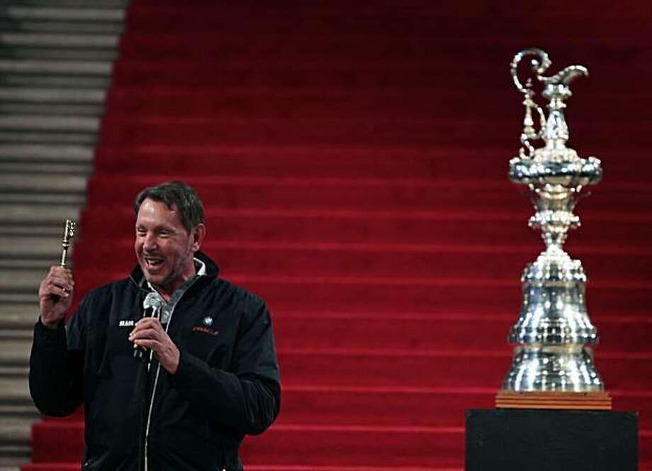 Larry Ellison owner of BMW Oracle Racing team holds up a key to the city presented to him by San Francisco Mayor Gavin Newsom during a ceremony at San Francisco City Hall on Saturday. Ellison and his team won the 33rd America's Cup in Spain earlier this month as representatives of The Golden Gate Yacht Club. Photo: Lance Iversen, The Chronicle