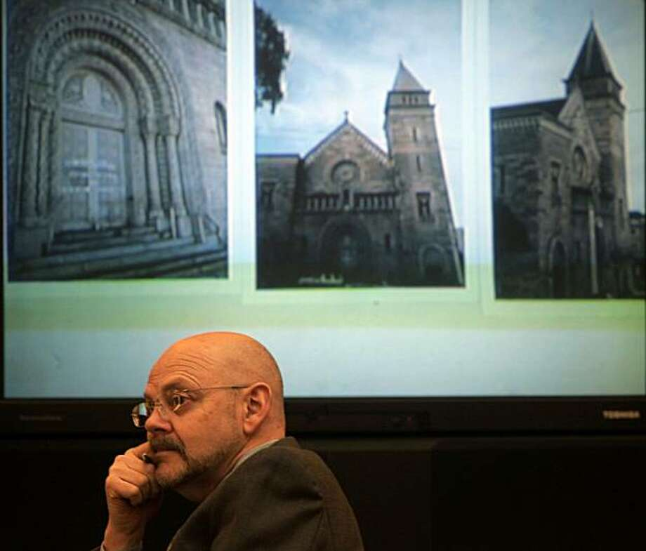 Charles Edwin Chase from the San Francisco Architectural Heritage waits in front of projected images of St. Brigid Church to speak. Photo: Lance Iversen, The Chronicle