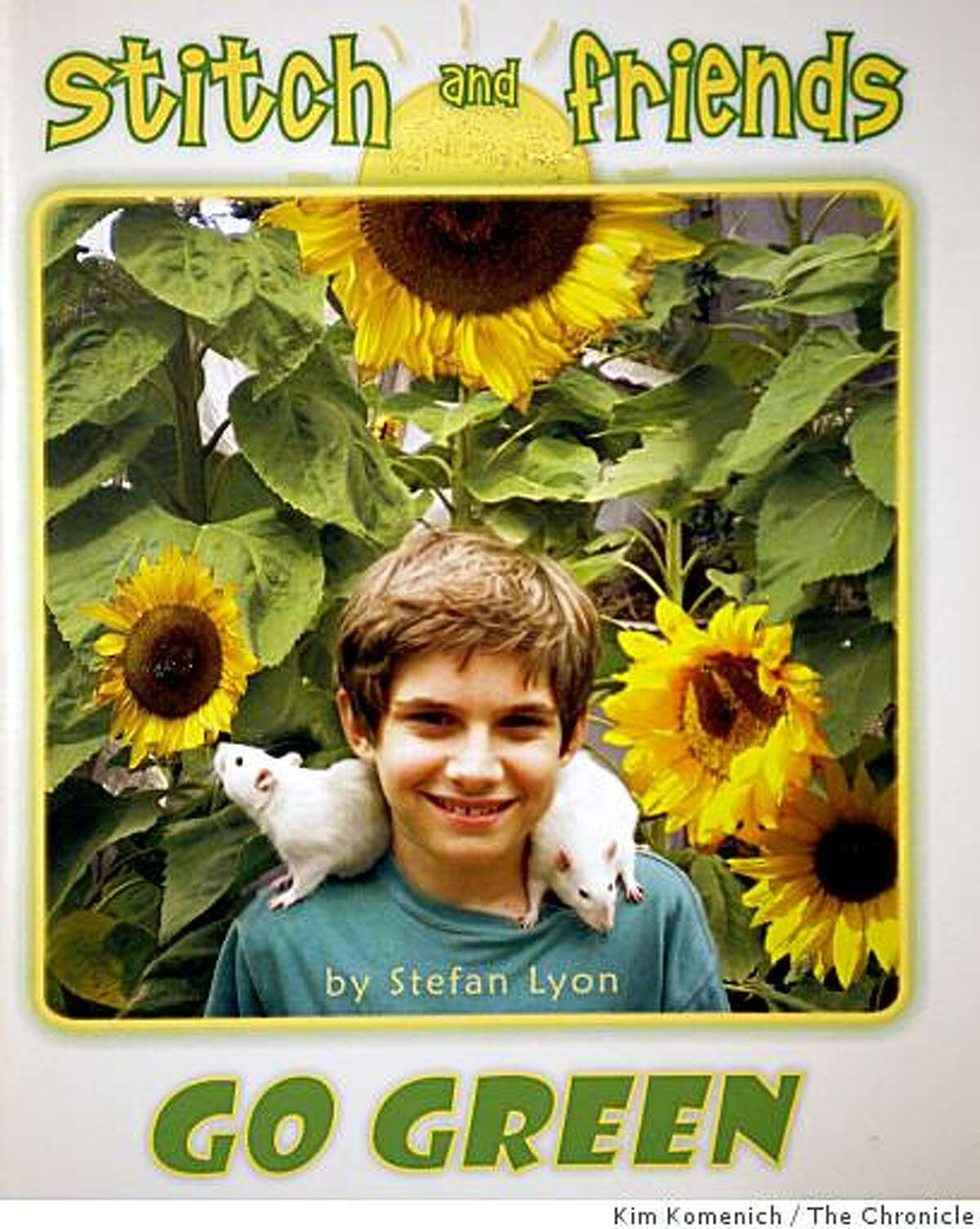 Stefan Lyon, 13, of San Francsico, Calif. signs copies of his third book