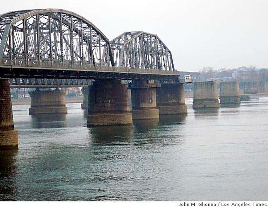 CHINA WARMUSEUM: The Broken Bridge in Dandong. The span was nearly destroyed during U.S. bombing raids. The Chinese rebuilt their side and turned it into a living history museum. Illustrates CHINA-WARMUSEUM (category i) by John M. Glionna (c) 2008, Los Angeles Times. Moved Tuesday, Dec. 9, 2008. (MUST CREDIT: Los Angeles Times photo by John M. Glionna.)The Broken Bridge in Dandong. The span was nearly destroyed during U.S. bombing raids. The Chinese rebuilt their side and turned it into a living history museum. Illustrates CHINA-WARMUSEUM (category i) by John M. Glionna (c) 2008, Los Angeles Times. Moved Tuesday, Dec. 9, 2008. (MUST CREDIT: Los Angeles Times photo by John M. Glionna.) Photo: John M. Glionna, Los Angeles Times