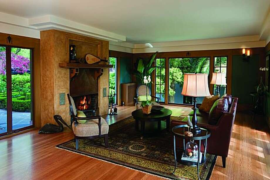 The living room is anchored by a fireplace. Photo: Courtesy Scott Fitzgerrell