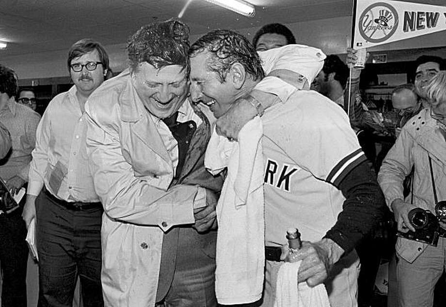 GFILE - This Oct. 9, 1977, file photo shows George Steinbrenner, left, principal owner of the Yankees, giving manager Billy Martin a bearhug and congratulations after each was doused by champagne in a dressing room at Royals Stadium,  after the Yankees defeated the Kansas City Royals, 5-3, to take the AL championship. Steinbrenner, who rebuilt the New York Yankees into a sports empire with a mix of bluster and big bucks that polarized fans all across America, died Tuesday, July 13, 2010. He had just celebrated his 80th birthday July 4. Photo: Associated Press 1977