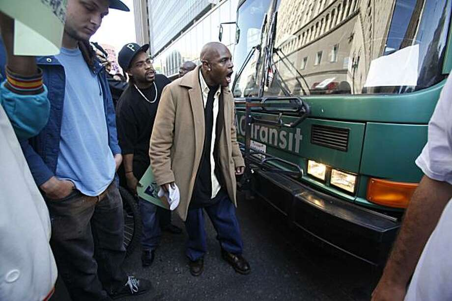 A man yells to try to prevent a bus from traveling down Broadway near city center after jurors convicted Johannes Mehserle on involuntary manslaughter on Thursday July, 8, 2010 in Oakland, Calif. Photo: Mike Kepka, The Chronicle