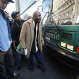 A man yells to try to prevent a bus from traveling down Broadway near city center after jurors convicted Johannes Mehserle on involuntary manslaughter on Thursday July, 8, 2010 in Oakland, Calif.